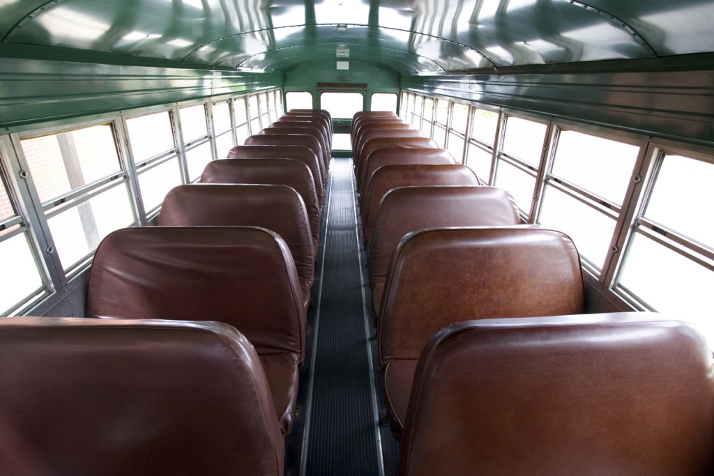 He was driving the bus from a back seat