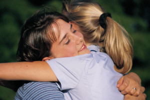 Visualise hugging and comforting yourself as you were back then, or hugging and comforting the child in the dream.